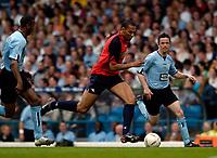 Fotball<br /> England 2004/2005<br /> Foto: SBI/Digitalsport<br /> NORWAY ONLY<br /> <br /> Lucas Radebe Testimonial, Leeds United XI v International XI, 02/05/2005.<br /> <br /> John Carew (C) takes on Gary Kelly