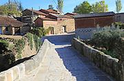 Stone bridge and paprika drying buildings, Cuacos de Yuste, La Vera, Extremadura, Spain