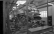 03/02/1964<br /> 02/03/1964<br /> 03 February 1964 <br /> Lincoln and Nolan new assembly shop, East Road, East Wall, Dublin. The line was built specially for the assembly of the new Austin 1100. Picture showing workers lowing the body onto the chassis.