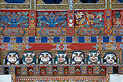 Traditional wood carving and decoration over a doorway at Ugyen Pelri Palace, Bhutan