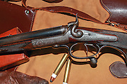 Boss & Co under-lever .410 double rifle manufactured in 1874, with ammunition and accessories.