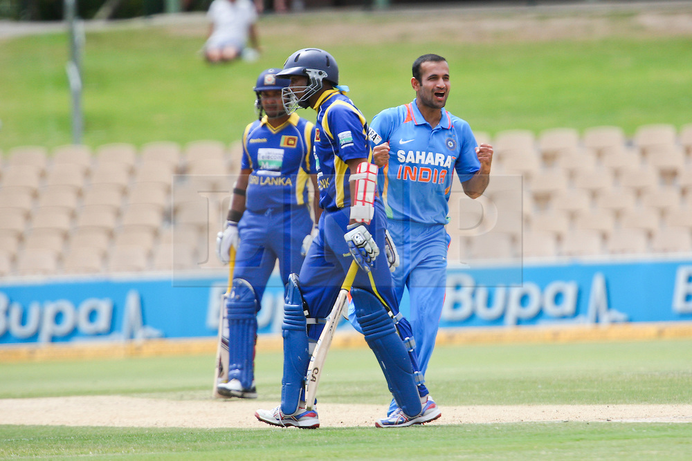 © Licensed to London News Pictures. 14/02/2012. Adelaide Oval, Australia. Indian bowler Irfan Pathan celebrates after getting the wicket of Tillakaratne Dilshan during the One Day International cricket match between India Vs Sri Lanka. Photo credit : Asanka Brendon Ratnayake/LNP