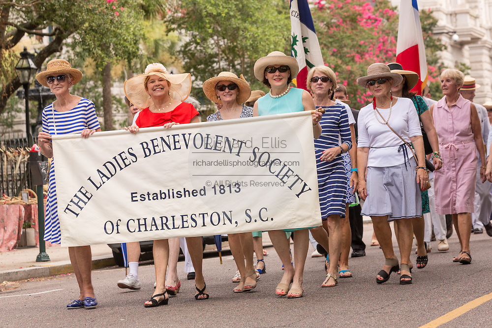 Members of the Ladies Benevolent Society march down Meeting Street to celebrate Carolina Day June 28, 2014 in Charleston, SC. Carolina Day celebrates the 238th anniversary of the American victory at the Battle of Sullivan's Island over the Royal Navy and the British Army.