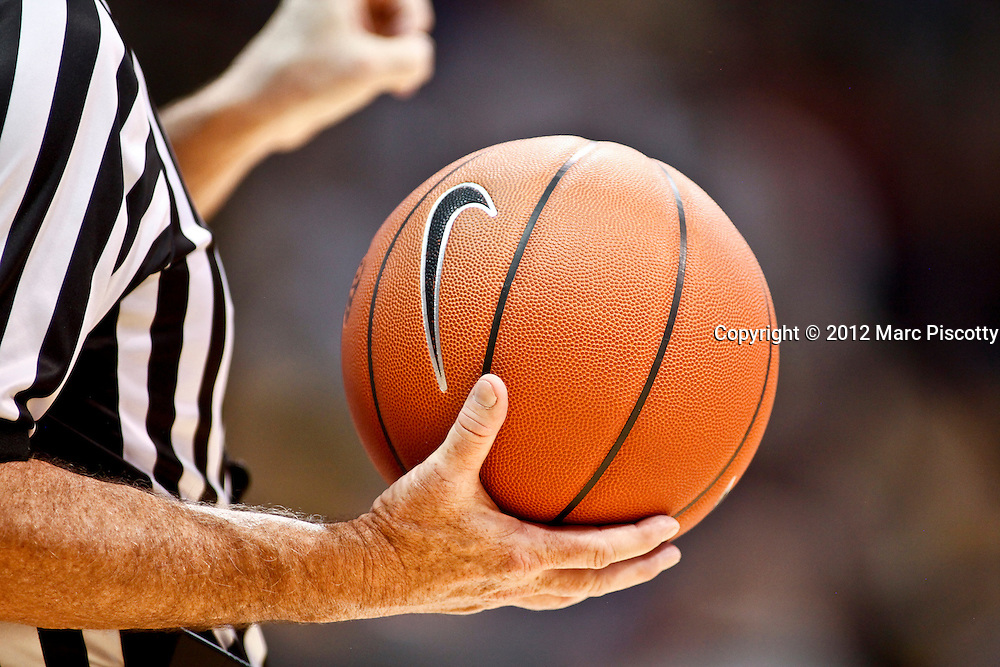 SHOT 1/21/12 5:51:12 PM - A referee holds a basketball during a timeout as Colorado plays Arizona during their PAC 12 regular season men's basketball game at the Coors Events Center in Boulder, Co. Colorado won the game 64-63..(Photo by Marc Piscotty / © 2012)