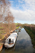 Narrowboats moored on the Kennet and Avon canal at Honey Street, Vale of Pewsey, Wiltshire, England, UK