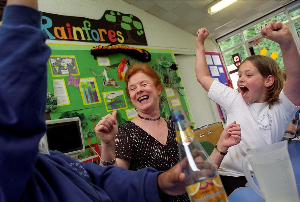Female teacher working with deaf children in a special school,