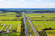 Nederland, Zuid-Holland, Gemeente Reeuwijk, 15-07-2012; autosnelweg A12 doorsnijdt het Groene Hart ter hoogte van Waarder, Bodegraven aan de horizon..Highway A12 runs through the Green Heart of the Netherlands..luchtfoto (toeslag), aerial photo (additional fee required).foto/photo Siebe Swart