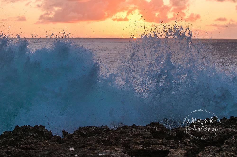 Wave breaking on lava shelf, Oahu, Hawaii