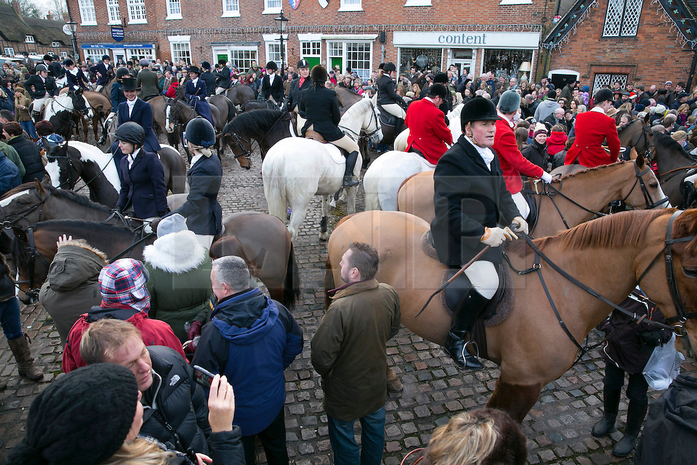 © Licensed to London News Pictures. 26/12/2013. Market Bosworth, Leicestershire, UK. The tradditional Market Bosworth Hunt meet took place today. Pictured, Riders prepare in the Market Square before the ride through the Town Centre. Photo credit : Dave Warren/LNP