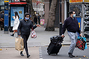As Londoners await the imminent second coronavirus lockdown it's business as usual in the West End with large numbers of people, some wearing face masks and some not, on what will be the last weekend before a month-long total lockdown in the UK on 1st November 2020 in London, United Kingdom. The three tier system in the UK has not worked sufficiently, to suppress the virus, and there have have been calls by politicians for a 'circuit breaker' complete lockdown to be announced to help the growing spread of the Covid-19.