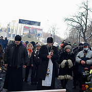 January 25, 2014 - Kiev, Ukraine: Anti-government protestors pray as demonstrations continue outside the Dynamo Kiev stadium near the Independence Square in central Kiev. (Paulo Nunes dos Santos)