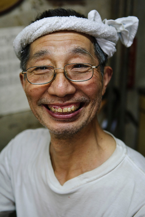 Portraits of people who work at Tsukiji fish market, Tokyo, Japan, April 2, 2007. The Tokyo Metropolitan Central Wholesale Market, better known as Tsukiji market, is the largest fish market in the world. Tsukiji is both a popular tourist attraction and a Mecca of Japanese food culture.