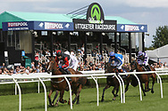 The horses and jockeys go past the stands during Uttoxeter Races at Uttoxeter Racecourse, Uttoxeter, United Kingdom on 30 July 2017. Photo by John Potts.