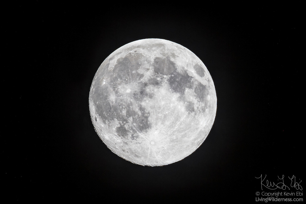 """The full moon shines against the night sky. Captured during the """"super moon"""" on August 9, 2014. A supermoon occurs when the moon is full at the same time as it makes its closest approach to Earth, a part of the moon's elliptical orbit known as perigee. The moon's distance from Earth varies between 222,000 and 252,000 miles (357,000 to 406,000 km). A supermoon can be up to 14 percent larger and 30 percent brigher than a full moon at apogee, or the farthest point from Earth."""