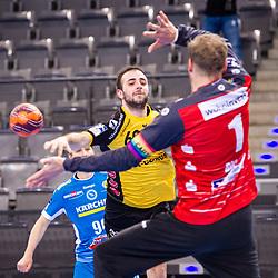 Milos Grozdanic (HSC 2000 Coburg #69) ; Johannes Bitter (TVB Stuttgart #1) ; 1. Handball-Bundesliga, HBL: TVB Stuttgart - HSC 2000 Coburg am 06.02.2021 in Stuttgart (PORSCHE Arena), Baden-Wuerttemberg<br /> <br /> Foto © PIX-Sportfotos *** Foto ist honorarpflichtig! *** Auf Anfrage in hoeherer Qualitaet/Aufloesung. Belegexemplar erbeten. Veroeffentlichung ausschliesslich fuer journalistisch-publizistische Zwecke. For editorial use only.