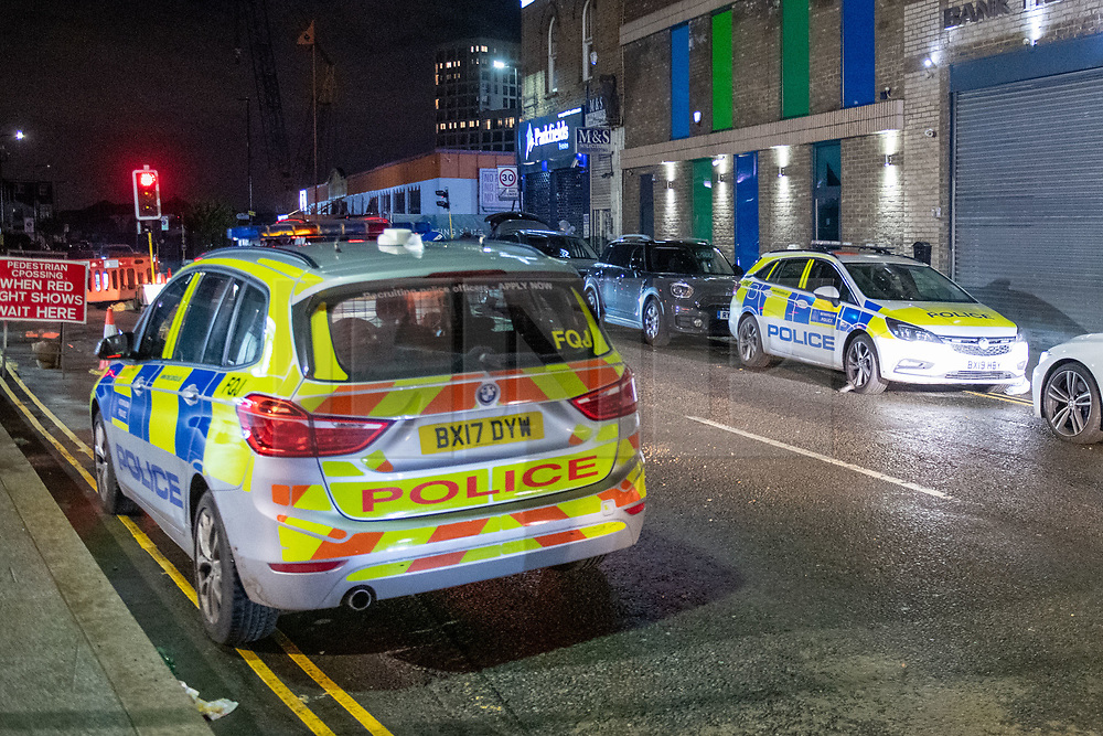 © Licensed to London News Pictures. 18/12/2020. London, UK. Police vehicles parked close to the crime scene. Police are investigating what is believed to be a 'body in a suitcase', locals reported the police were at the property from approximately 15:00GMT on Friday 18th December. Photo credit: Peter Manning/LNP