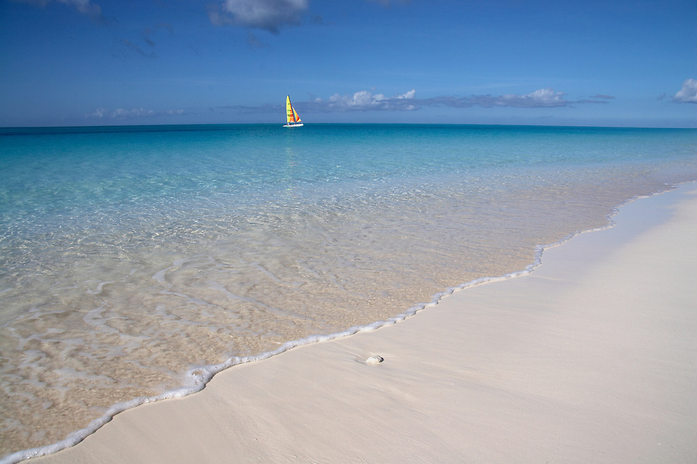 Grace Bay Beach with colorful sailboat, Providenciales, BWI