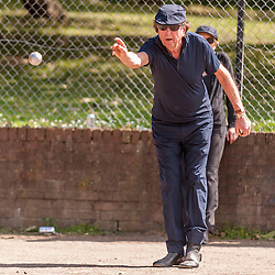 """© Licensed to London News Pictures. 05/06/2015.   London, UK. Monty Python star, Eric Idle, takes part in """"Freddie for the Day"""", by playing a special game of celebrity Pétanque, competing for the Londonaise 'Celebrity Pétanque Trophy', ahead of The Londonaise Pétanque festival this weekend in Barnard Park, Islington.  The festival will set a new precedent in the UK with 128 teams taking part in the main tournament.  The event also aims to raise funds for the Mercury Phoenix Trust to fight against AIDS worldwide. Photo credit : Stephen Chung/LNP"""