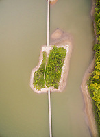 Aerial view of natural sand island connected by a footbridge, Netherlands.
