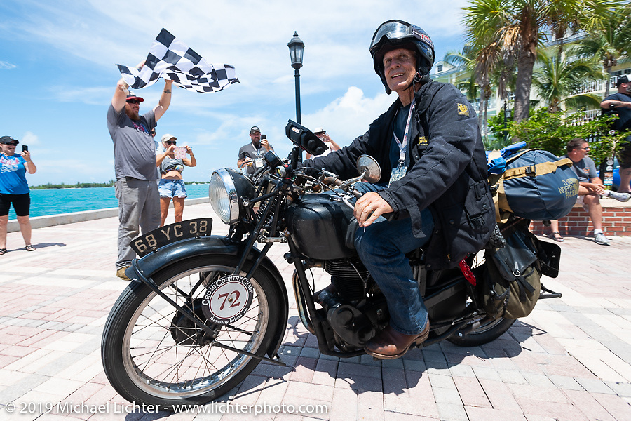 Larry Luce rides his 1938 Velocette KSS across the finish line of the Cross Country Chase motorcycle endurance run from Sault Sainte Marie, MI to Key West, FL. (for vintage bikes from 1930-1948). The Grand Finish in Key West's Mallory Square after the 110 mile Stage-10 ride from Miami to Key West, FL and after covering 2,368 miles of the Cross Country Chase. Sunday, September 15, 2019. Photography ©2019 Michael Lichter.