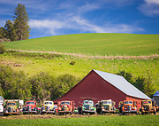 Old barn building and trucks in the agricultural Palouse area of eastern Washington state. The Palouse is a region of the northwestern United States, encompassing parts of southeastern Washington, north central Idaho and, in some definitions, extending south into northeast Oregon. It is a major agricultural area, primarily producing wheat and legumes.