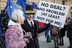 London, UK. 9th January, 2019. EU Supergirl Madeleina Kay stands with a fellow anti-Brexit activist disguised as Jacob Rees-Mogg and carrying a sign reading 'My Money's on Brexit My Money's in Ireland' during a protest by pro-EU group SODEM (Stand of Defiance European Movement) outside Parliament on the first day of the debate in the House of Commons on Prime Minister Theresa May's proposed Brexit withdrawal agreement.