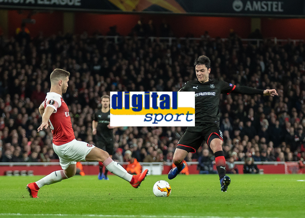 Football - 2018 / 2019 UEFA Europa League - Round of Sixteen, Second Leg: Arsenal (1) vs. Rennes (3)<br /> <br /> Shkodran Mustafi (Arsenal FC) throws himself into a full bloodied challenge with Clement Grenier (Rennes FC) at The Emirates.<br /> <br /> COLORSPORT/DANIEL BEARHAM