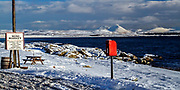 Loch Indaal and The Paps of Jura visible from outside Bruichladdich Minimarket - locally known as Debbies