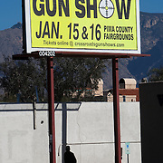 A billboard only miles from the Tucson shooting tragedy that killed several and injured US Congresswoman Gabrielle Giffords advertises for a gun show held 7 days after the mass shooting.