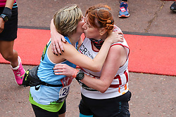 © Licensed to London News Pictures. 28/04/2019. London, UK. Runners hugging after running the Virgin Money London Marathon 2019. Photo credit: Dinendra Haria/LNP