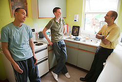Teenagers in hostel kitchen with Social worker.
