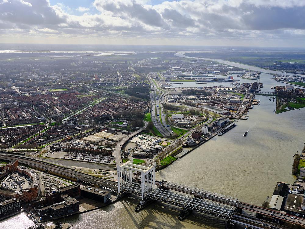 Nederland, Zuid-Holland, Dordrecht, 25-02-2020; Oude Maas, met Spoorbrug Dordrecht(Grote brug) tussen Dordrecht (links) enZwijndrecht. Zicht op havens van Dordrecht, met water van het Malle Gat en de Dordtsche Kil. Aan de verre horizon het Hollandsch Diep.<br /> Oude Maas (old Meuse), with Railway Bridge Dordrecht between Dordrecht (left) and Zwijndrecht. View of the ports of Dordrecht, river Dordtsche Kil and Hollandsch Diep is on the horizon.<br /> <br /> luchtfoto (toeslag op standard tarieven);<br /> aerial photo (additional fee required)<br /> copyright © 2020 foto/photo Siebe Swart