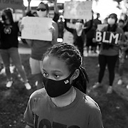 Irie Long, 10, watches the Black Lives Matter demonstration in Simi Valley, a conservative, predominantly white suburb of Los Angeles, in Juneteenth. Irie and her family live in Lake Balboa about 20 miles from Simi Valley, but came in support.