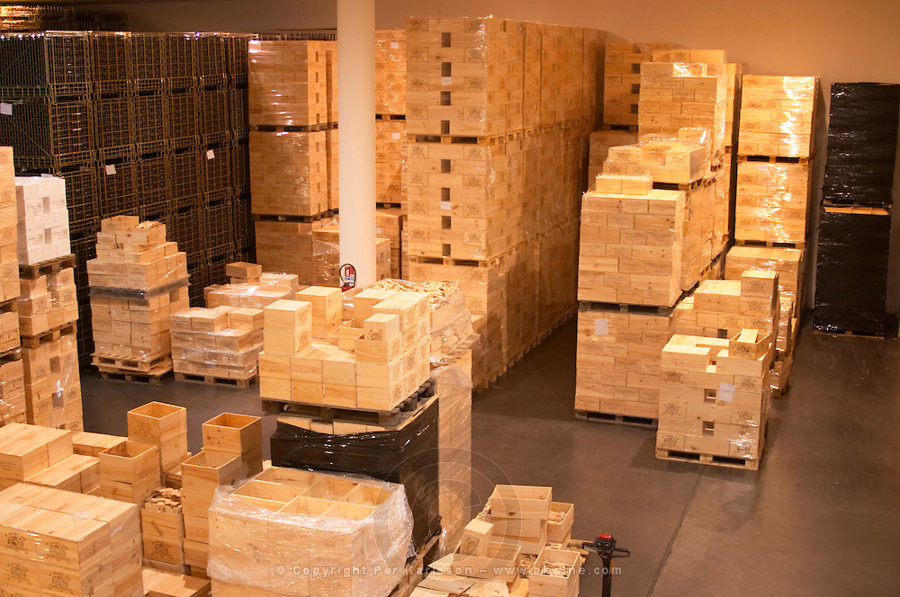 The winery, storage area for bottled wine in wooden cases and cardboard cartons - Chateau Baron Pichon Longueville, Pauillac, Medoc, Bordeaux, Grand Cru