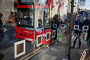 Passengers board a London bus at a bus stop in Kingston, on 7th November 2019, in London, England.