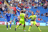 Cardiff City's Aron Gunnarsson (c) wins a header against the Reading midfield. EFL Skybet championship match, Cardiff city v Reading at the Cardiff city stadium in Cardiff, South Wales on Saturday 27th August 2016.<br /> pic by Carl Robertson, Andrew Orchard sports photography.