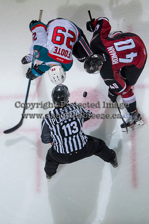 KELOWNA, BC - JANUARY 26:  Linesman Tim Plamondon drops the puck between Nolan Foote #29 of the Kelowna Rockets and Milos Roman #40 of the Vancouver Giants at Prospera Place on January 26, 2019 in Kelowna, Canada. (Photo by Marissa Baecker/Getty Images)