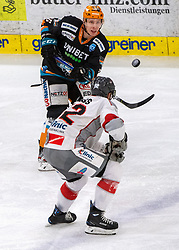 21.02.2021, Keine Sorgen Eisarena, Linz, AUT, EBEL, EHC Liwest Black Wings Linz vs iClinic Bratislava Capitals, 48. Qualifikationsrunde, im Bild v.l. Juha-Pekka Hytönen (Steinbach Black Wings 1992), Brock Higgs (iClinic Bratislava Capitals) // during the bet-at-home ICE Hockey League 48th qualifying round match between EHC Liwest Black Wings Linz and iClinic Bratislava Capitals at the Keine Sorgen Eisarena in Linz, Austria on 2021/02/21. EXPA Pictures © 2021, PhotoCredit: EXPA/ Reinhard Eisenbauer
