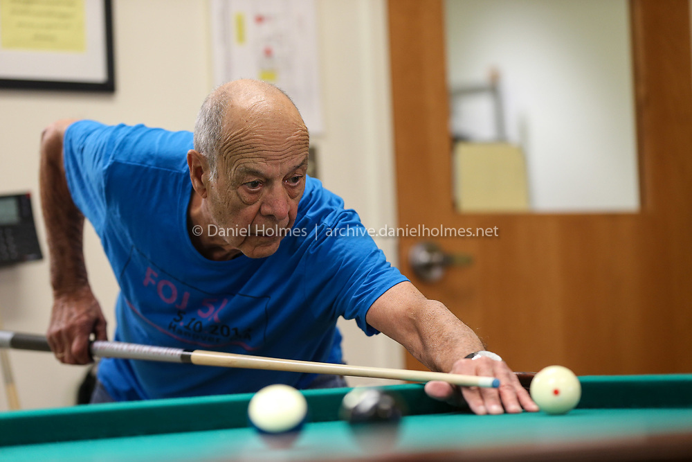 (3/26/19, NATICK, MA) Connie Porzio, of Natick, shoots some pool at the Natick Community-Senior Center on Tuesday. [Daily News and Wicked Local Photo/Dan Holmes]