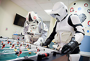 I captured this image of Star Wars characters, AT-AT Driver Joe Bialek of Bolingbrook and Biker Scout Chris Kowalski of Oswego, playing foosball in the pediatric unit at Central DuPage Hospital while they waited to visit some of the sick children on December 17, 2017.