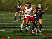 Destiny Jones charges the ball during NHIAA Division III Field Hockey with White Mountain on Wednesday afternoon.  (Karen Bobotas/for the Laconia Daily Sun)