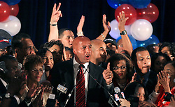 May 20th, 2006. New Orleans, Louisiana. Mayor Ray Nagin celebrates victory with his family and supporters at the Marriiott Hotel in the race for Mayor of New Orleans as he is once again elected to office, beating off challenger Mitch Landrieu. Nagin's wife Seletha and 7 year old daughter Tianna are to his right.<br /> Photo; Charlie Varley/varleypix.com