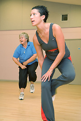 Women taking part in fitness class at Southglade Leisure Centre; Nottingham