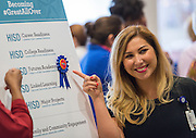 Central office staff enjoy ice cream and look over the new branding for departments, September 19, 2014.