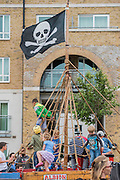 Children play on the pirate ship Albion - Royal Greenwich Tall Ships Festival with a fleet of square rigged ships moored on the Thames at Greenwich and Woolwich. The fleet includes two of the biggest Class A Tall Ships - the Dar Mlodziezy and Santa Maria Manuela - which are moored on Tall Ships Island in the river off Greenwich. Tall Ships Festival Day on Saturday 29 August featured free family entertainment and the chance to enjoy a taste of life on the high seas.