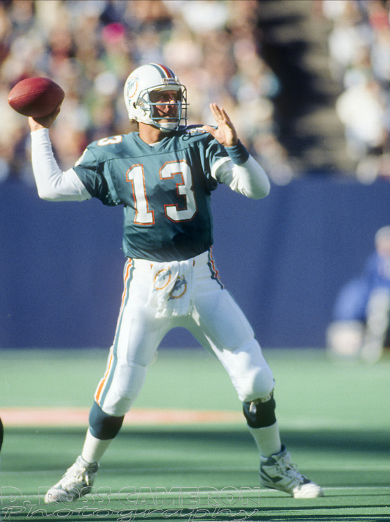 Miami Dolphins quarterback Dan Marino looks to pass against the New York Jets during an NFL football game, Sunday, Nov. 12, 1989 at Giants Stadium in East Rutherford, N.J. Marino passed for 359 yards and 3 touchdowns as the Dolphins won, 31-23. (Photo by D. Ross Cameron)