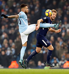 Manchester City's Nicolas Otamendi (left) and Tottenham Hotspur's Harry Kane battle for the ball during the Premier League match at the Etihad Stadium, Manchester.