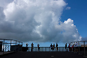 Tourists at viewpoint with white clouds