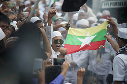 September 6, 2017 - Jakarta, Indonesia - Islamic Front Defender (FPI) burn Myanmar flag as a protest to end Rohingya massacre in front of Myanmar Embassy in Jakarta, Indonesia on September 6, 2017. Protester urges Indonesian government to put down Myanmar flag in the embassy and leave indonesia; liberate and ends violence against Rohingyas Muslim ethnic. (Credit Image: © Anton Raharjo/NurPhoto via ZUMA Press)