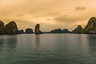 """Rock formation known to locals as """"The Thumb"""" juts out of Halong Bay."""